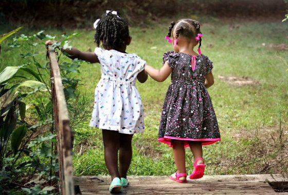 little_girls_holding_hands_c